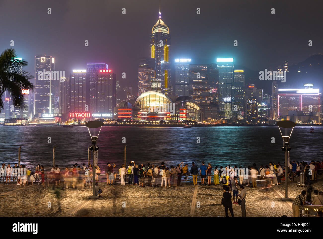 HONG KONG - OCTOBER 2, 2015: People, captured with blurred motion, enjoying the famous Hong Kong skyline from the - Stock Image