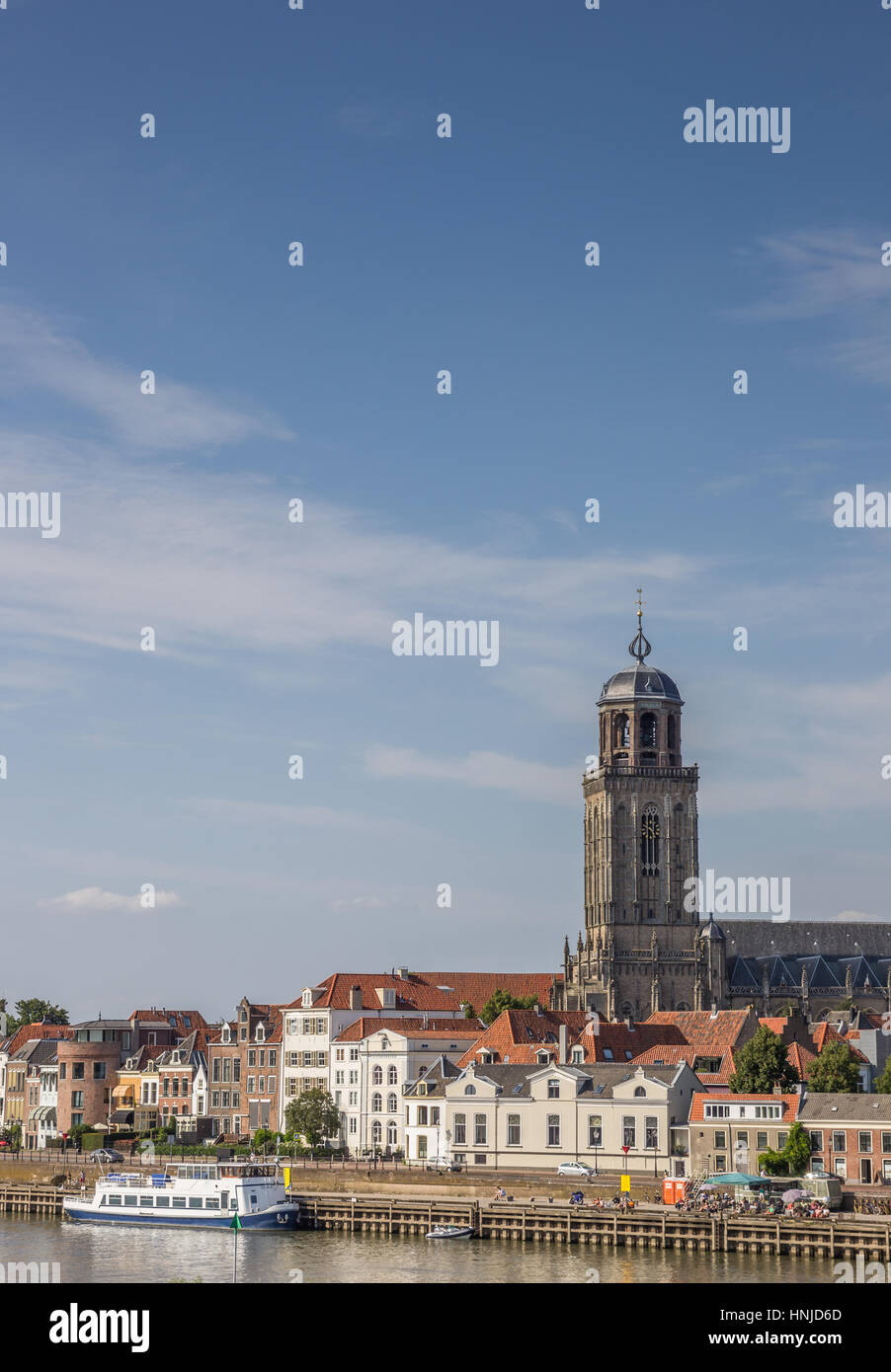 Old houses and Lebuinus church at the waterfront of Deventer, Holland Stock Photo