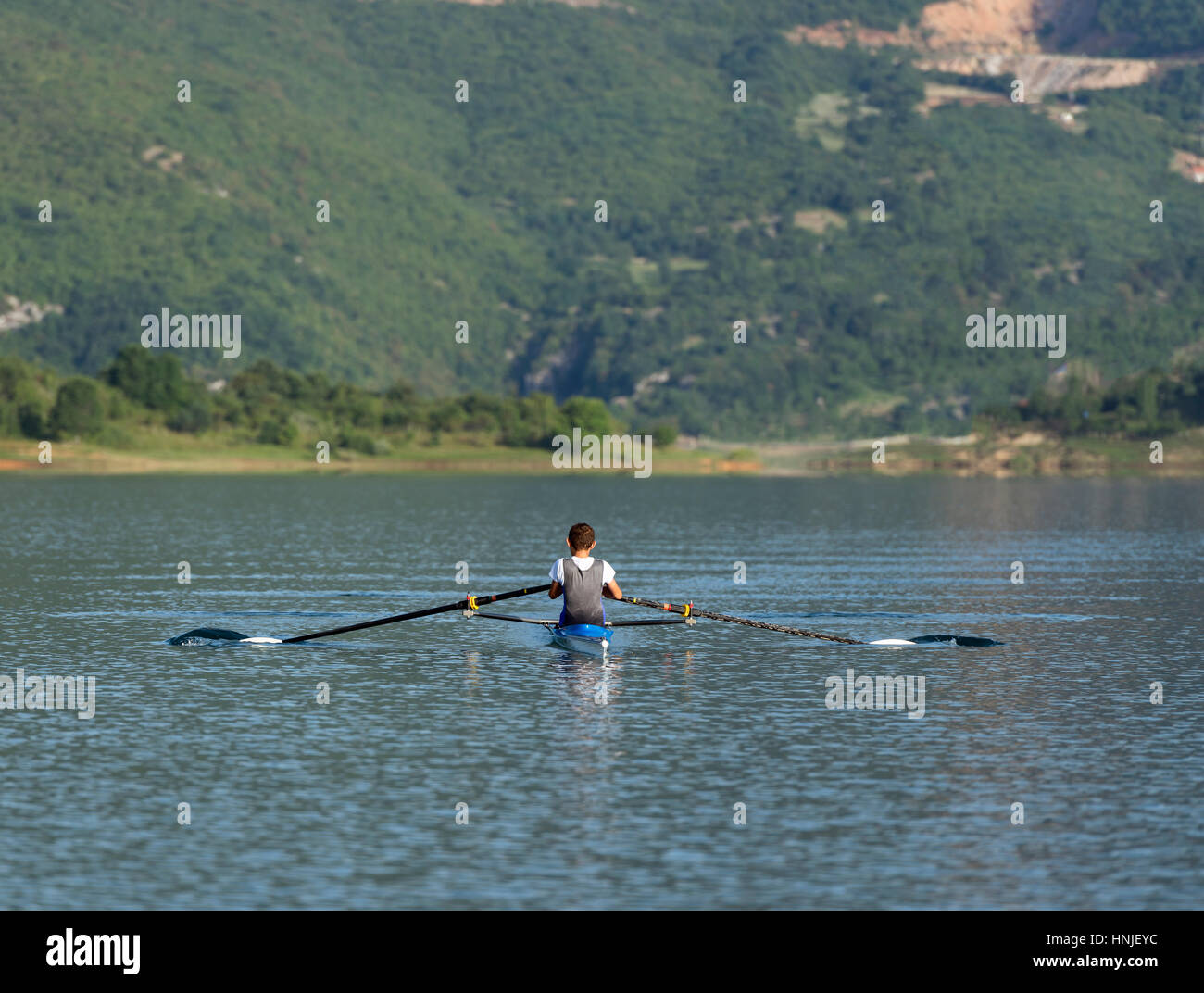Child in the course of rowing on single - Stock Image