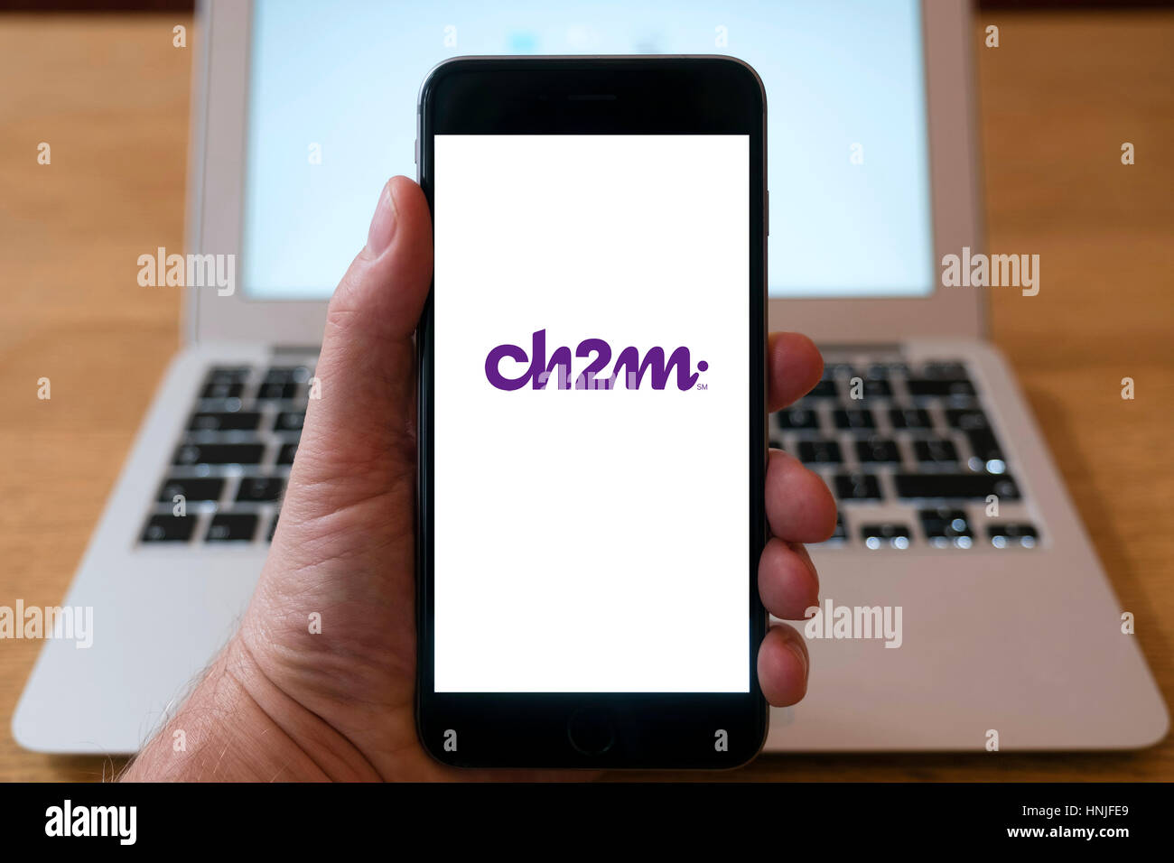 Logo of Ch2m engineering group on smart phone screen. - Stock Image