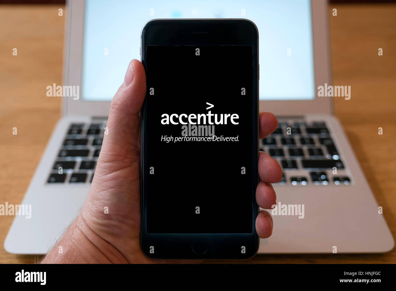 Accenture management consultant website on smart phone screen. - Stock Image