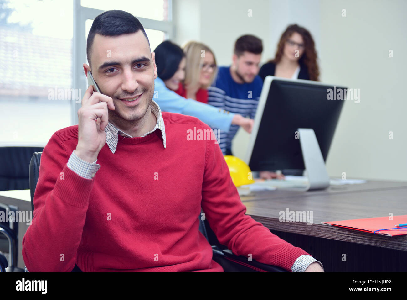 business concept - businessman talking on the phone in office - Stock Image