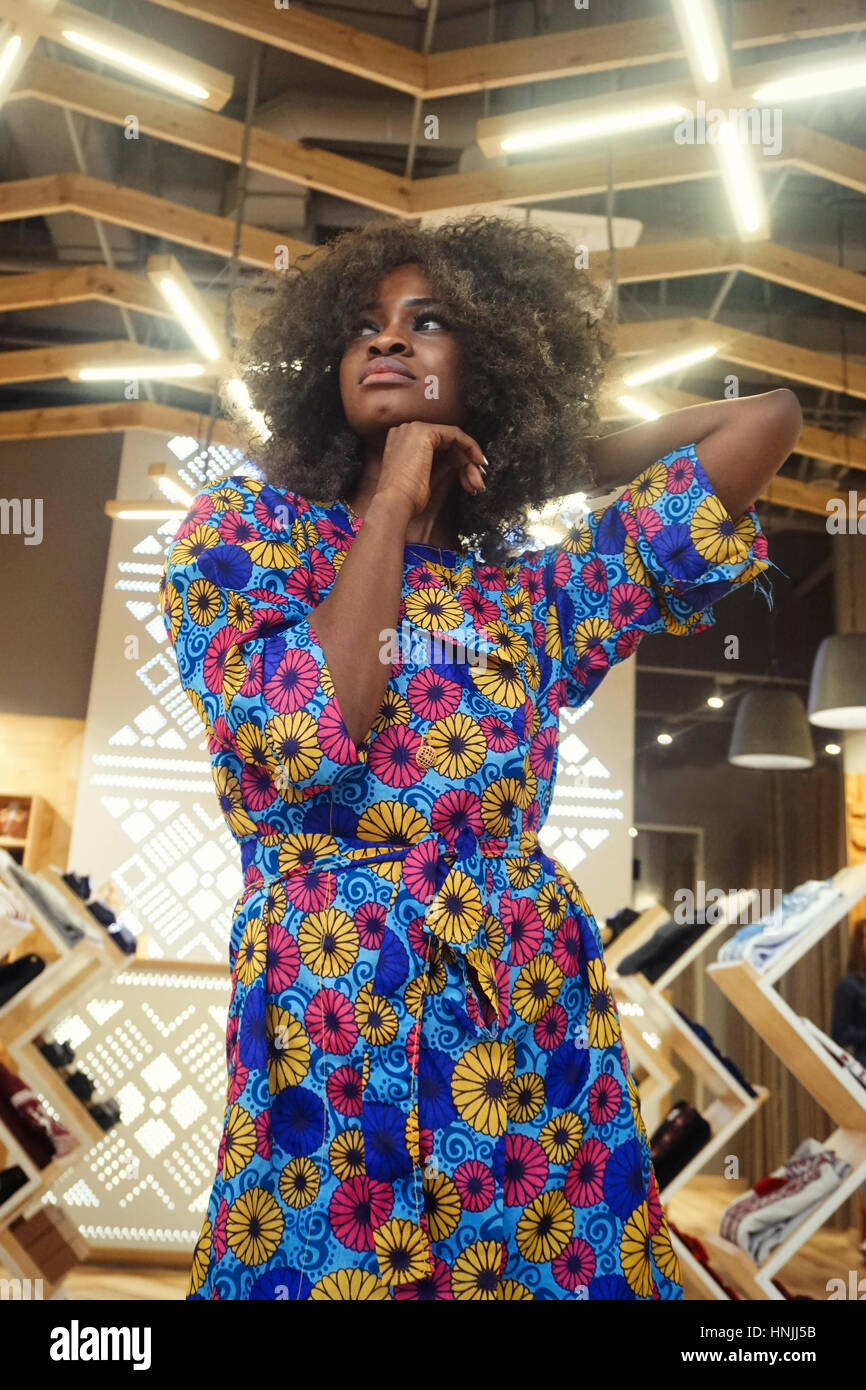 Beautiful afro-american wooman standing in a clothing shop Stock Photo