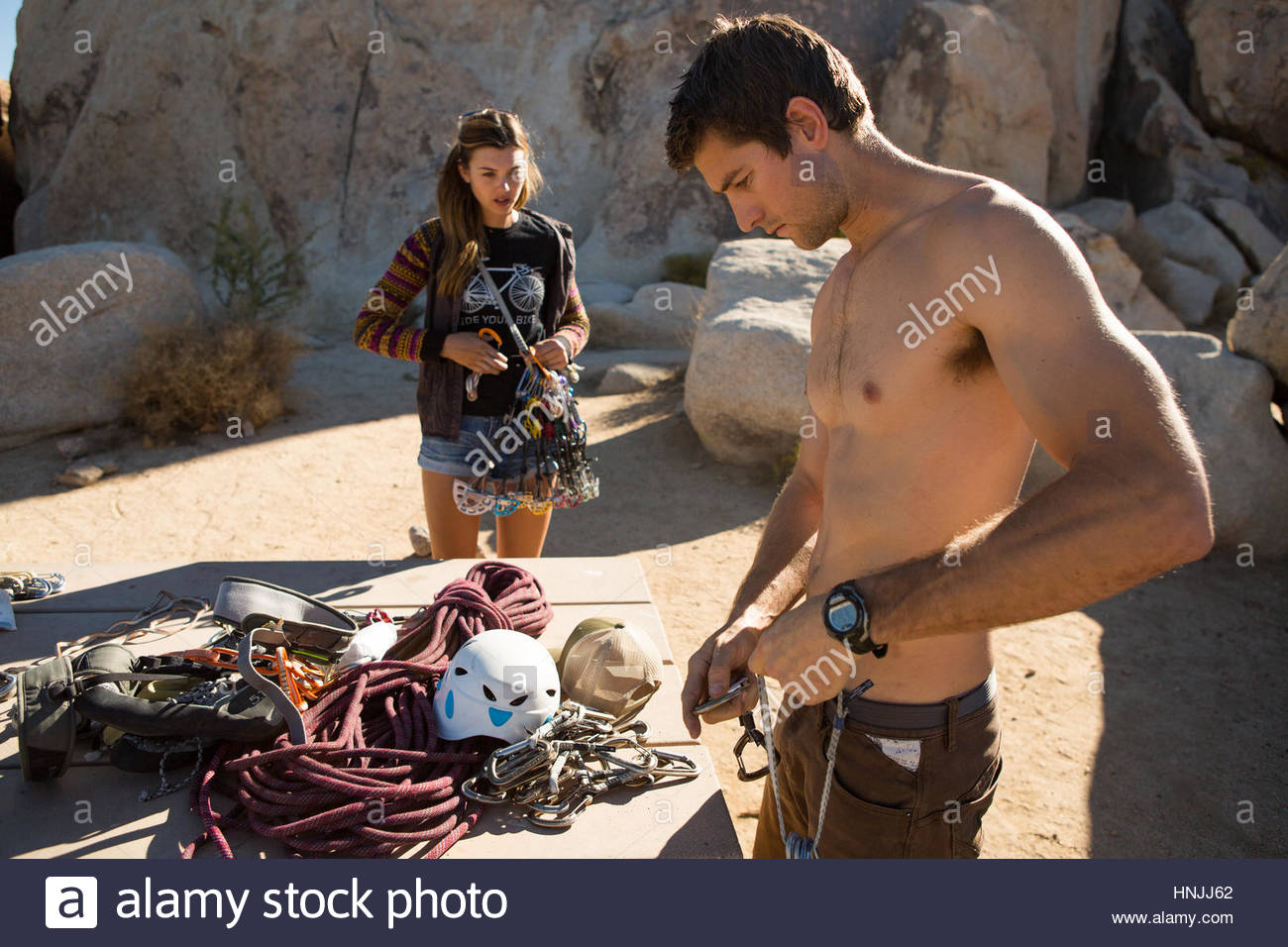 Climbers gearing up for a day of climbing in the desert of Joshua Tree National Park. - Stock Image