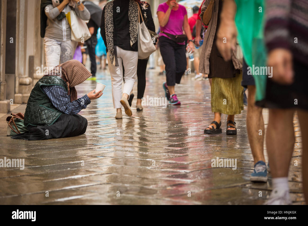 Beggar in the shopping center of Venice.It gets a greater problem in European cities since the economic crisis in - Stock Image