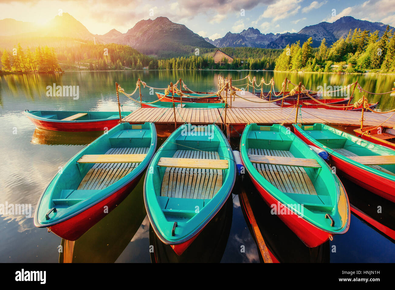 Boat on the dock surrounded mountains. Fantastic Shtrbske Pleso  - Stock Image
