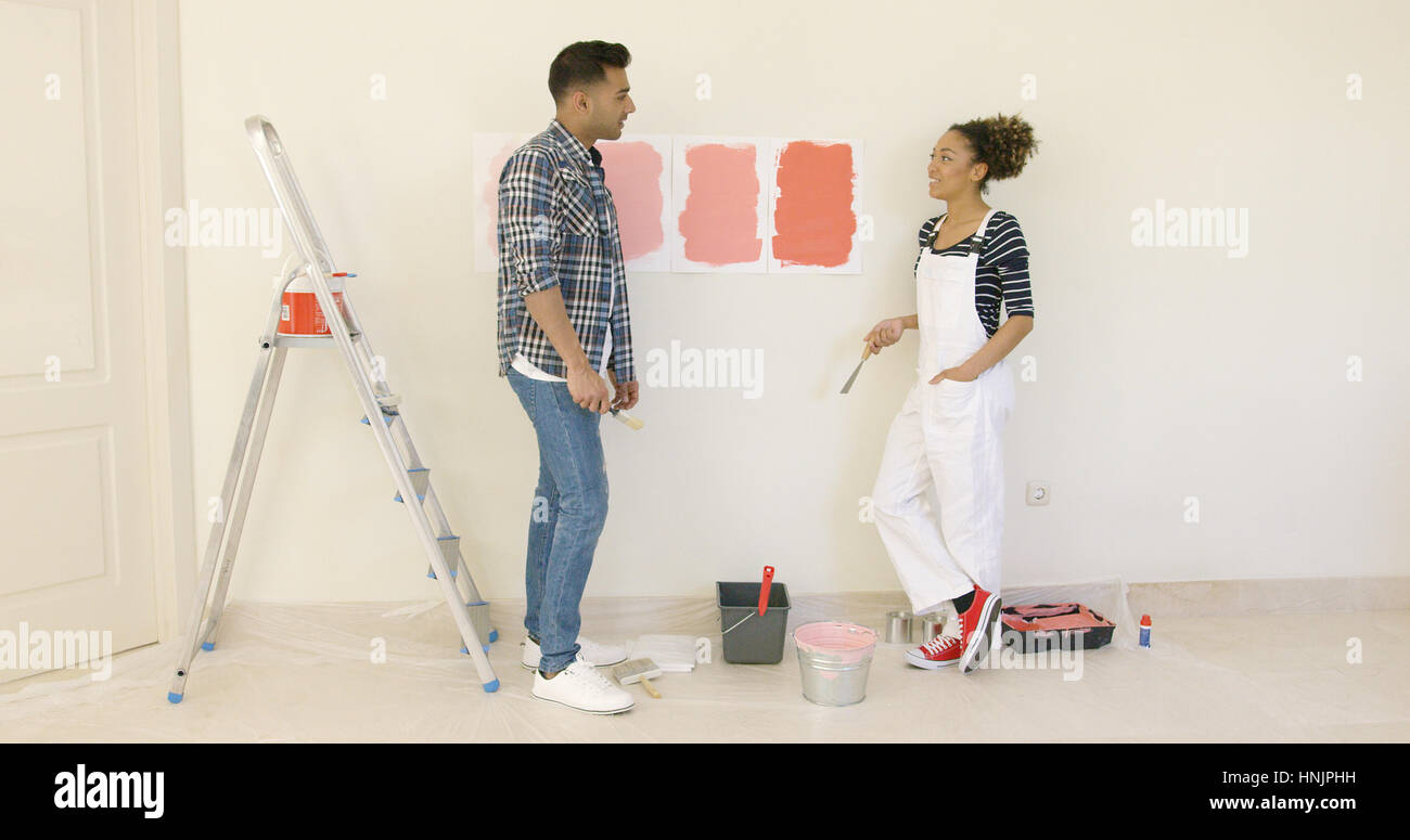 Young couple trying to decide on a paint color for the