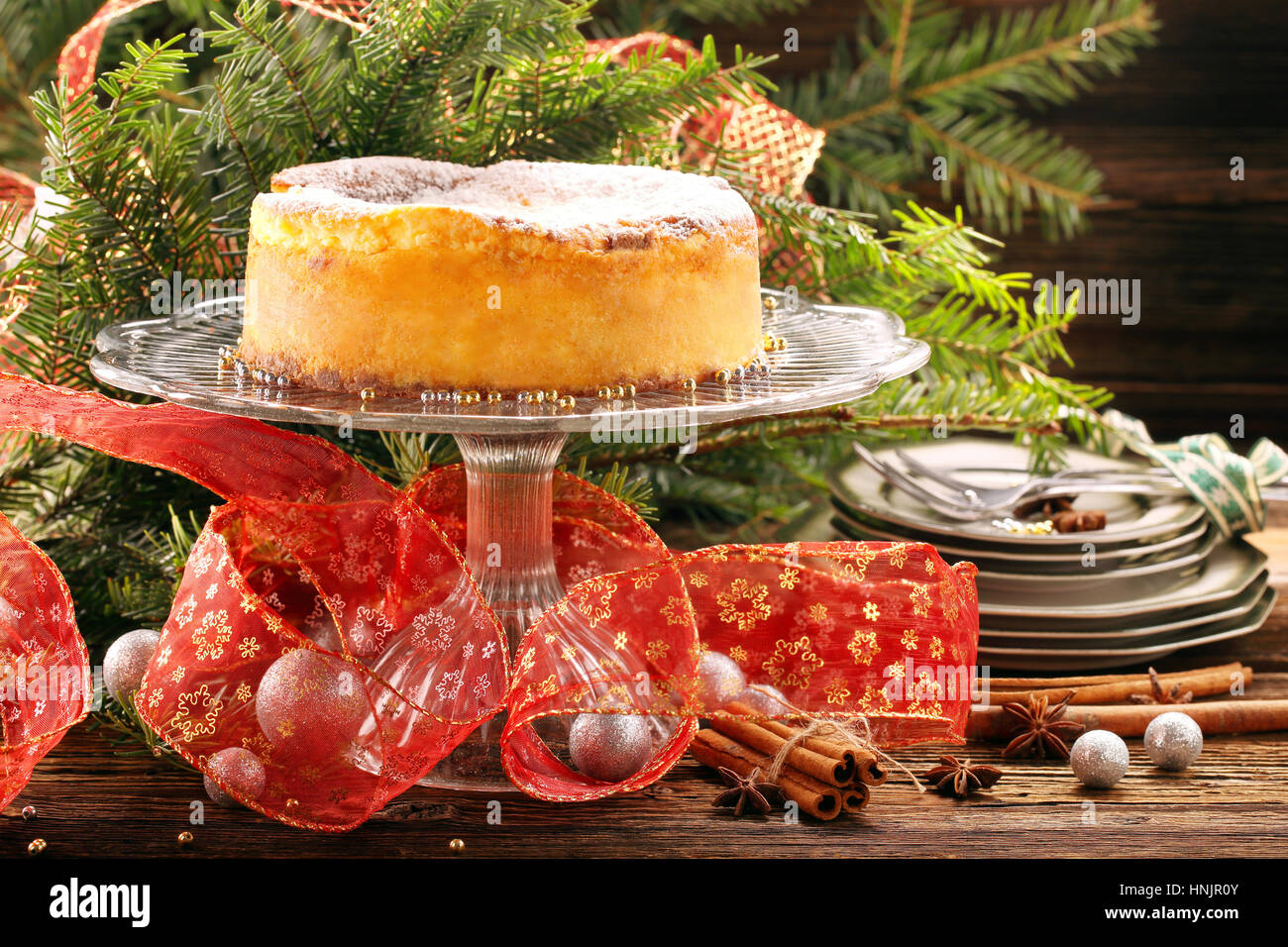 Traditional christmas cheese cake on wooden background - Stock Image