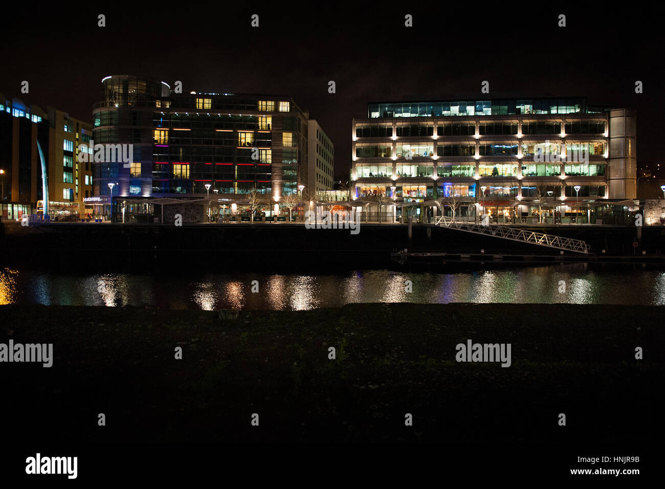 Clayton Hotel on Lapps Quay in Cork City at night which is part of the dockland rejuvenation - Stock Image