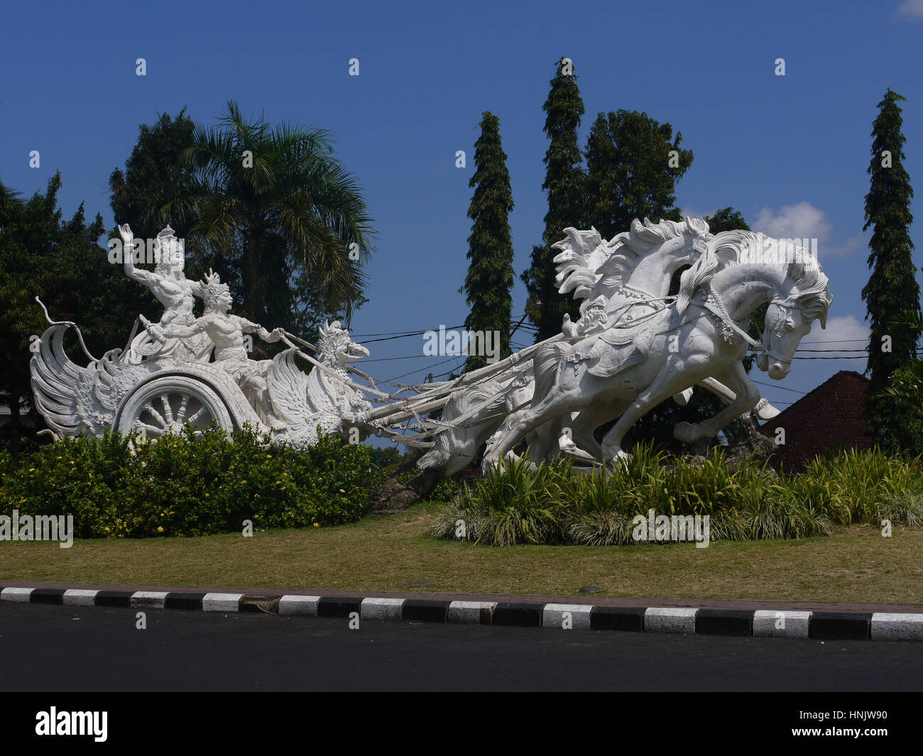 Arjuna and Krishna hindu gods riding chariot statue in Bali, Indonesia - Stock Image