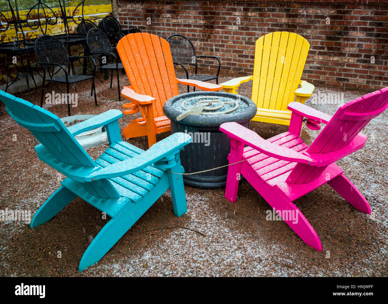 Colorful Outdoor Chairs In Snow On Patio Of Boathouse Cantina Restaurant;  Salida; Colorado: USA