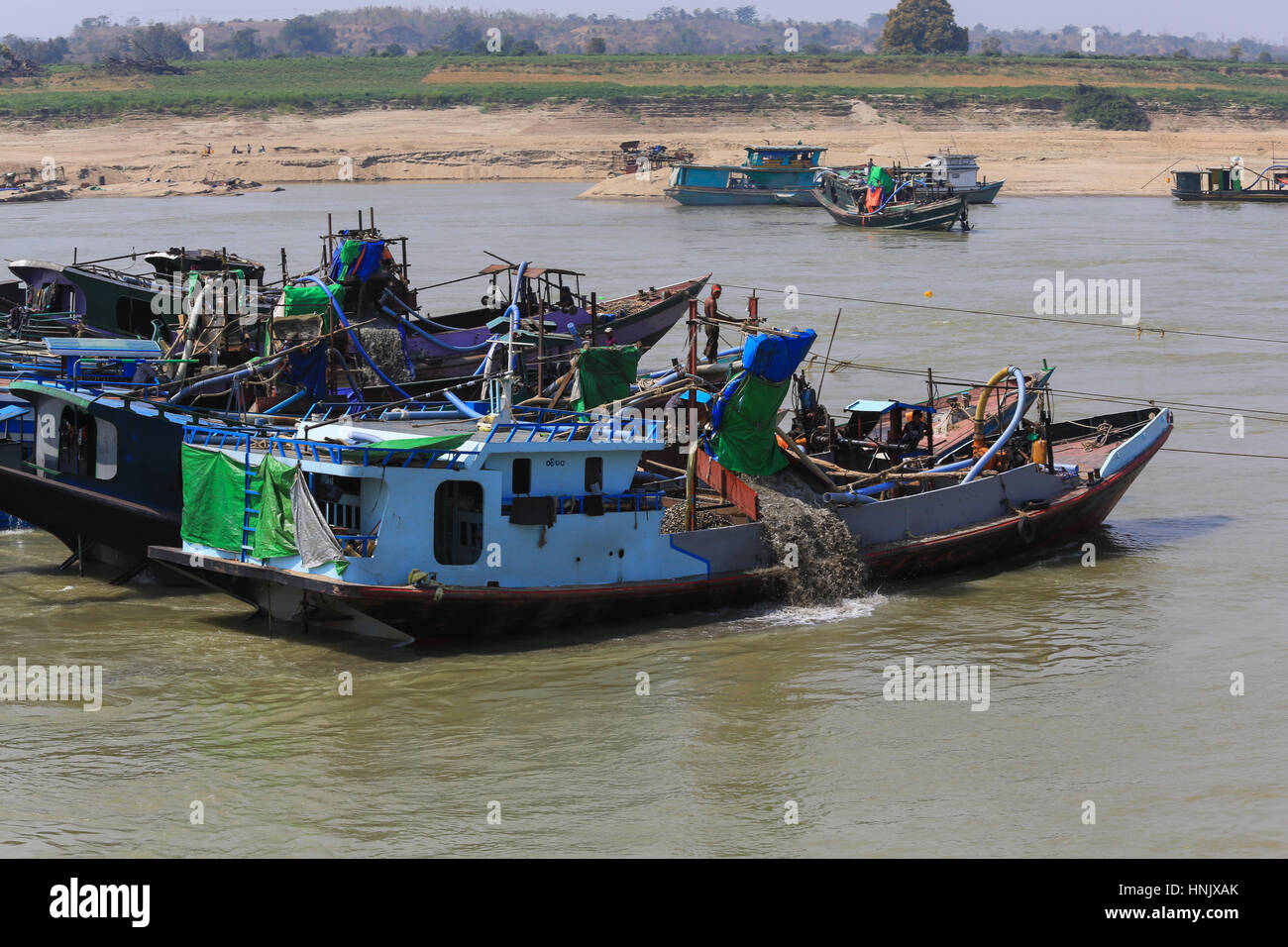 Several gold dredge boats on the Irrawaddy River in Myanmar (Burma