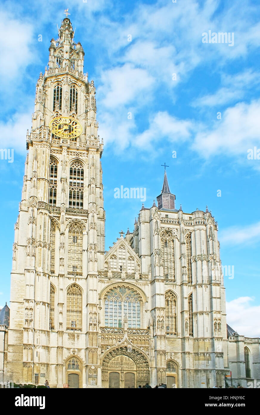 The splendid Gothic facade of the Cathedral of Our Lady of Antwerp, decorated with carved stone patterns and sculptures - Stock Image