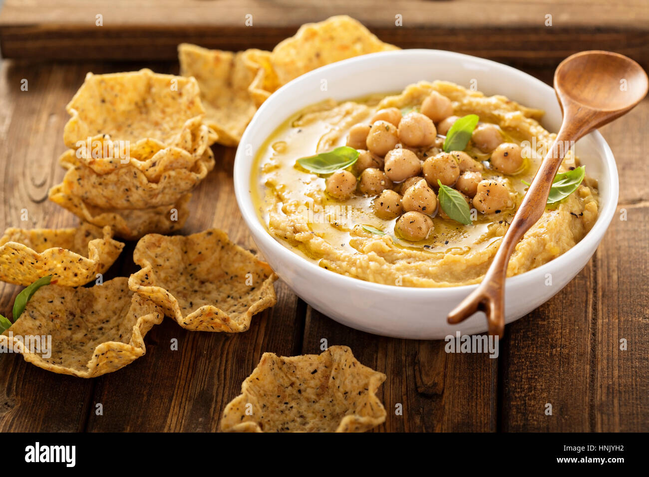 Homemade hummus with tortilla bowls, small appetizers - Stock Image