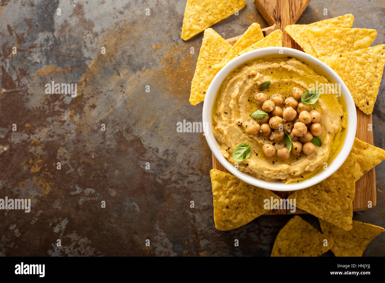 Homemade hummus with tortilla chips overhead shot - Stock Image