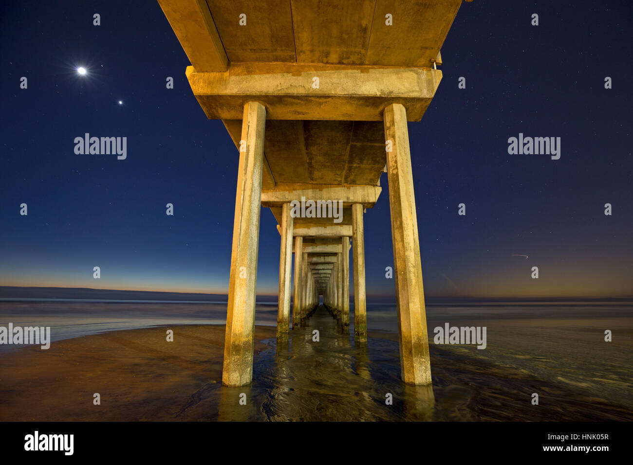 Scripps Institute of Oceanography Pier and the Stellar triangle formed by the Moon, Venus, and Mars, La Jolla, California - Stock Image