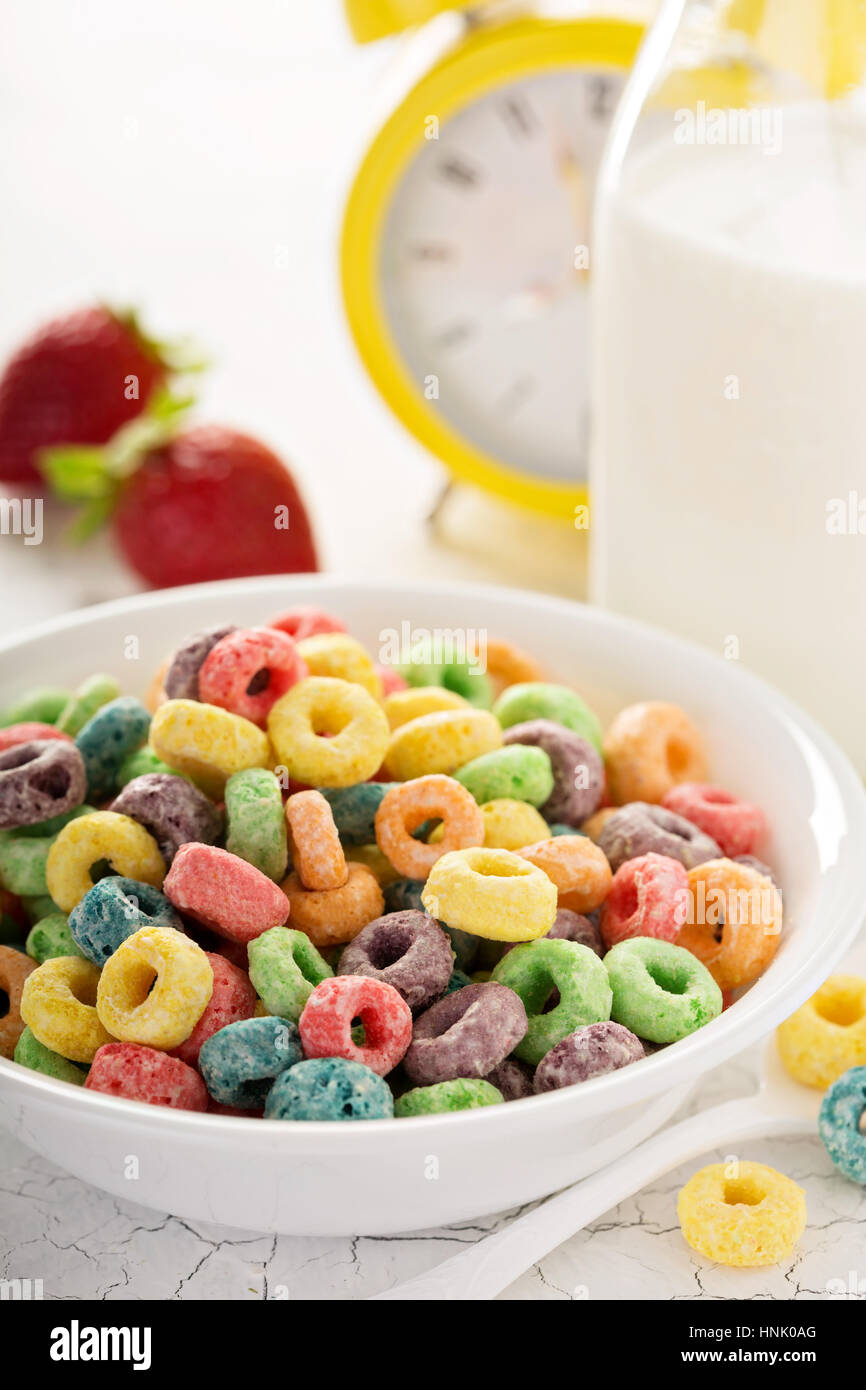 Fruit colorful sweet cereals in a bowl, traditional quick breakfast or snack for kids Stock Photo