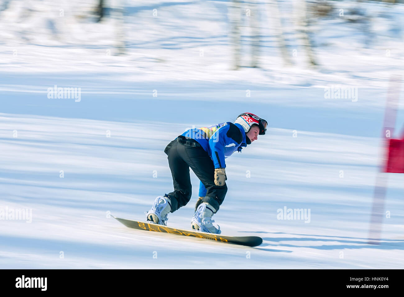 Irkutsk, Russia - February 12, 2017: Slalom competition snowboarding and skiing for adults and children in Irkutsk - Stock Image