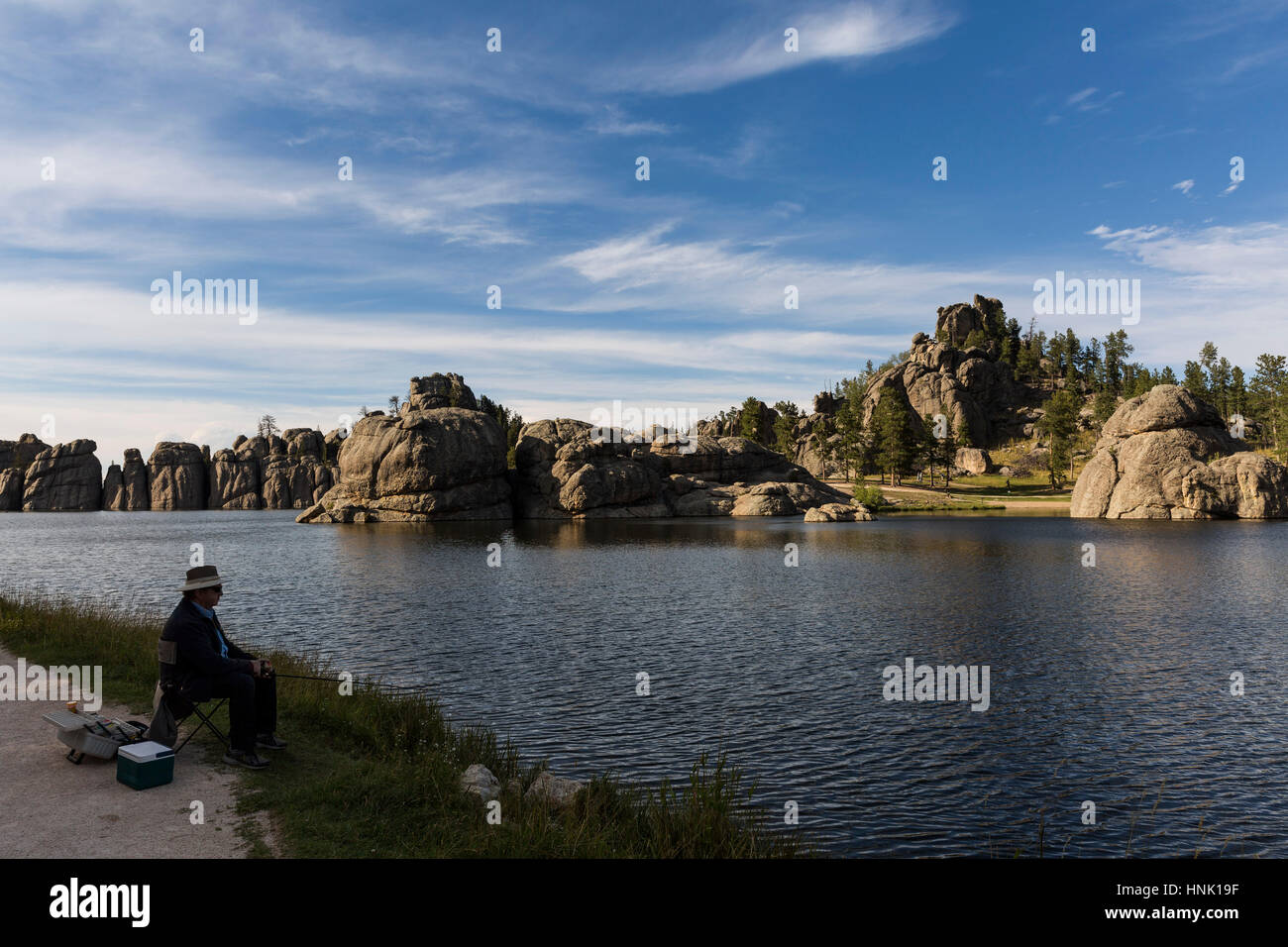 Man fishing at Sylvan Lake. Sept, 2016. Custer State Park, South Dakota, USA - Stock Image