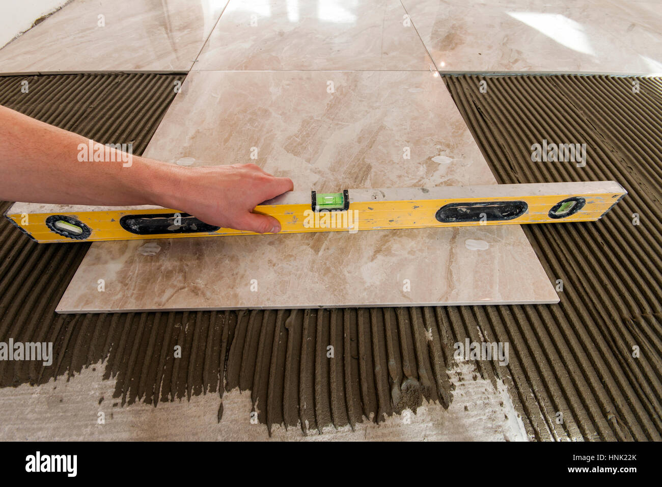Ceramic tiles and tools for tiler. Floor tiles installation. Home ...