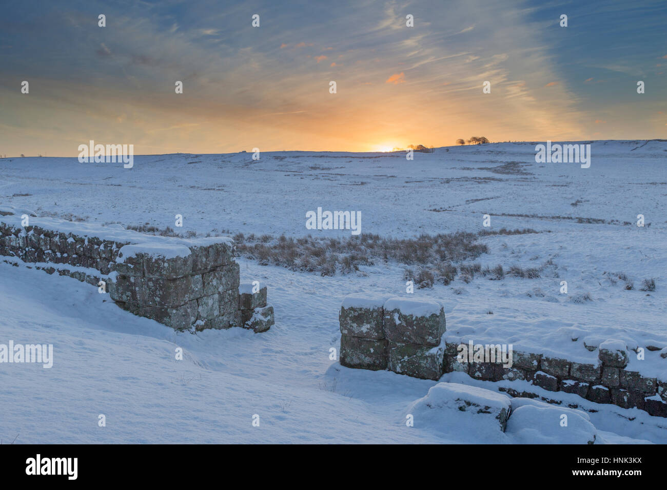 Hadrian's Wall: the south gate of Milecastle 42 at Cawfield at dawn on a cold, snowy winter's morning Stock Photo
