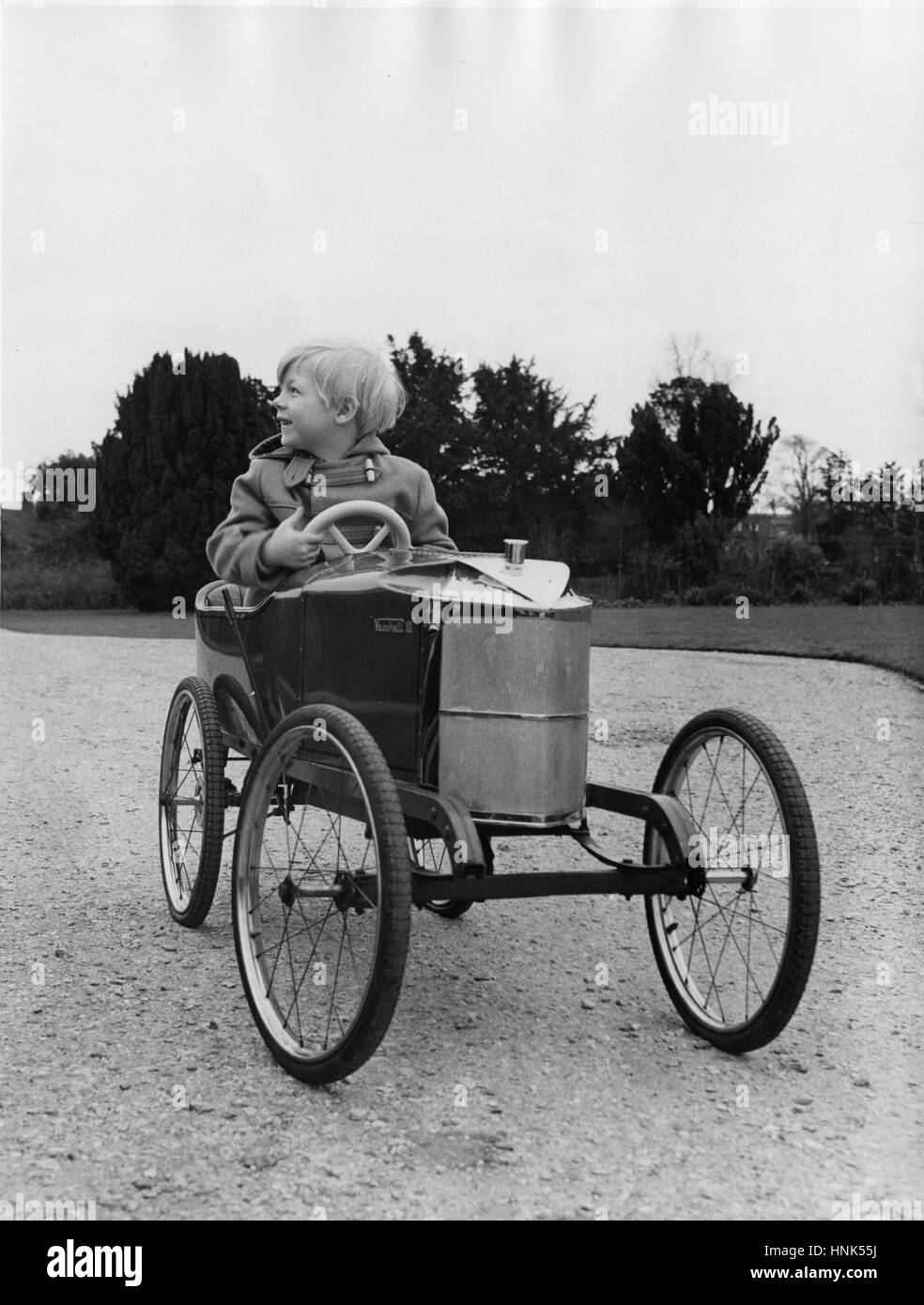 Ralph Montagu in Vauxhall pedal car (now Lord Montagu) - Stock Image