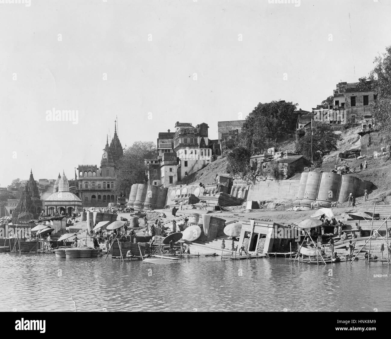 Scindia Ghat - Sunken Stairway and columns of the Shiva Temple, on the Ganges River, India. The construction of - Stock Image