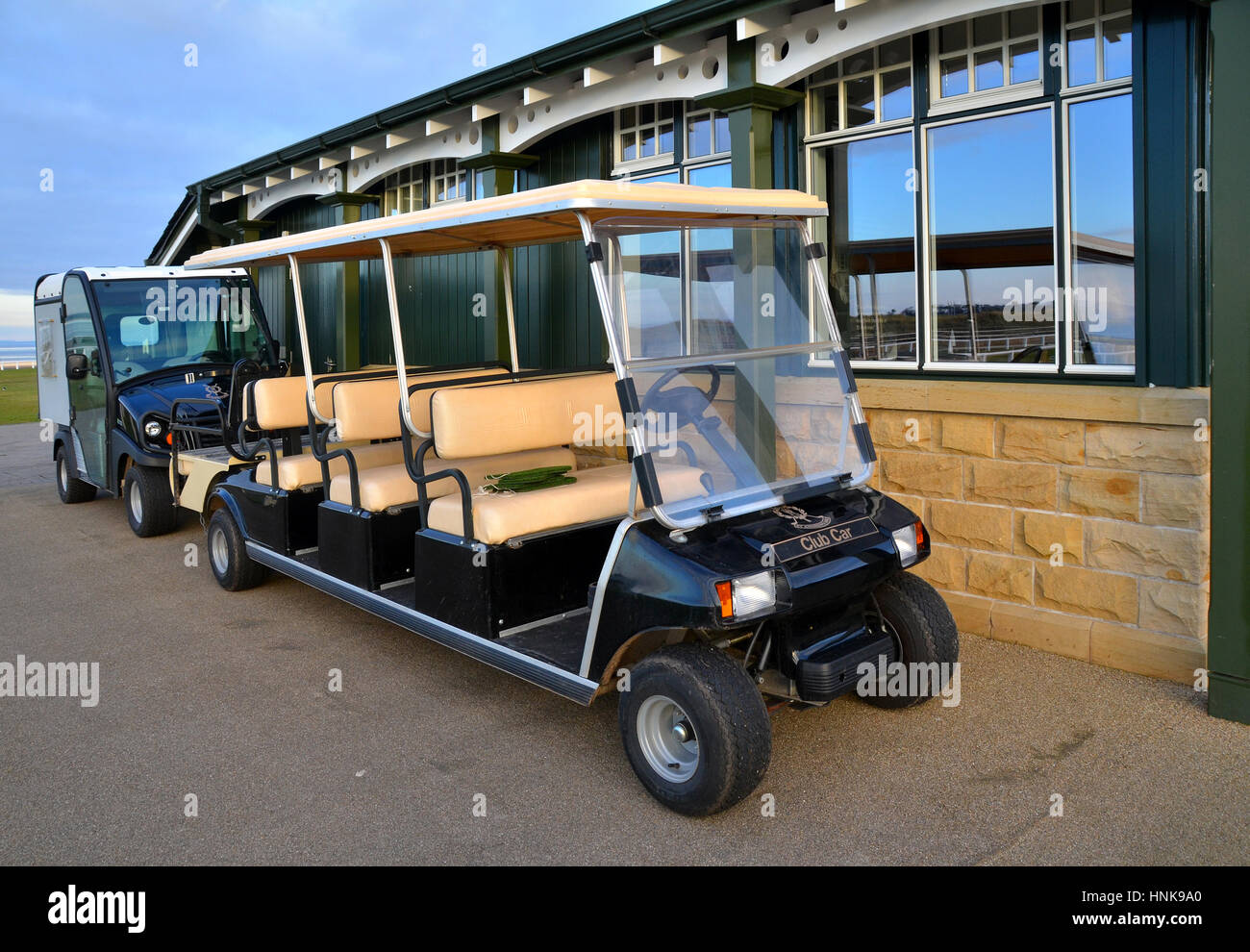 multi seater  club cars of the old course of St Andrews gold club in Fife, Scotland  parked infront of a section - Stock Image