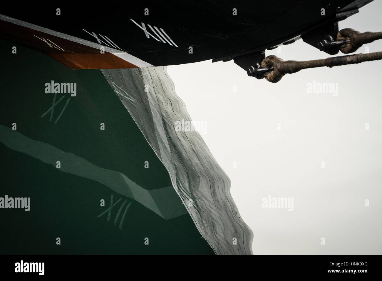 Bow of the replica schooner 'Bluenose II' reflects on the waters of Halifax Harbour, Nova Scotia, Canada. - Stock Image