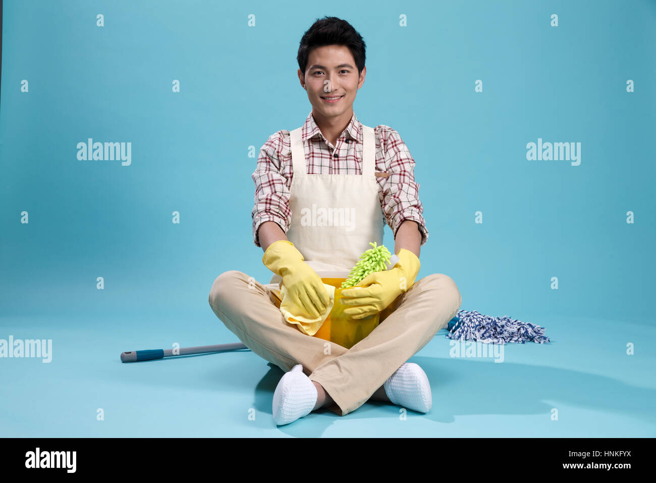 Young men do housework - Stock Image