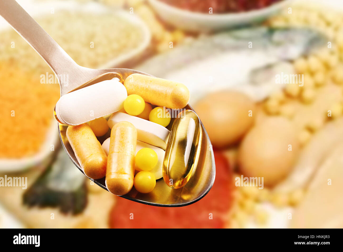 dietary supplements in spoon on protein food background - Stock Image