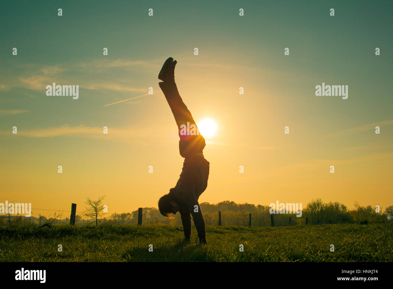 Handstand walk in the sun at the baltic sea in germany - Stock Image