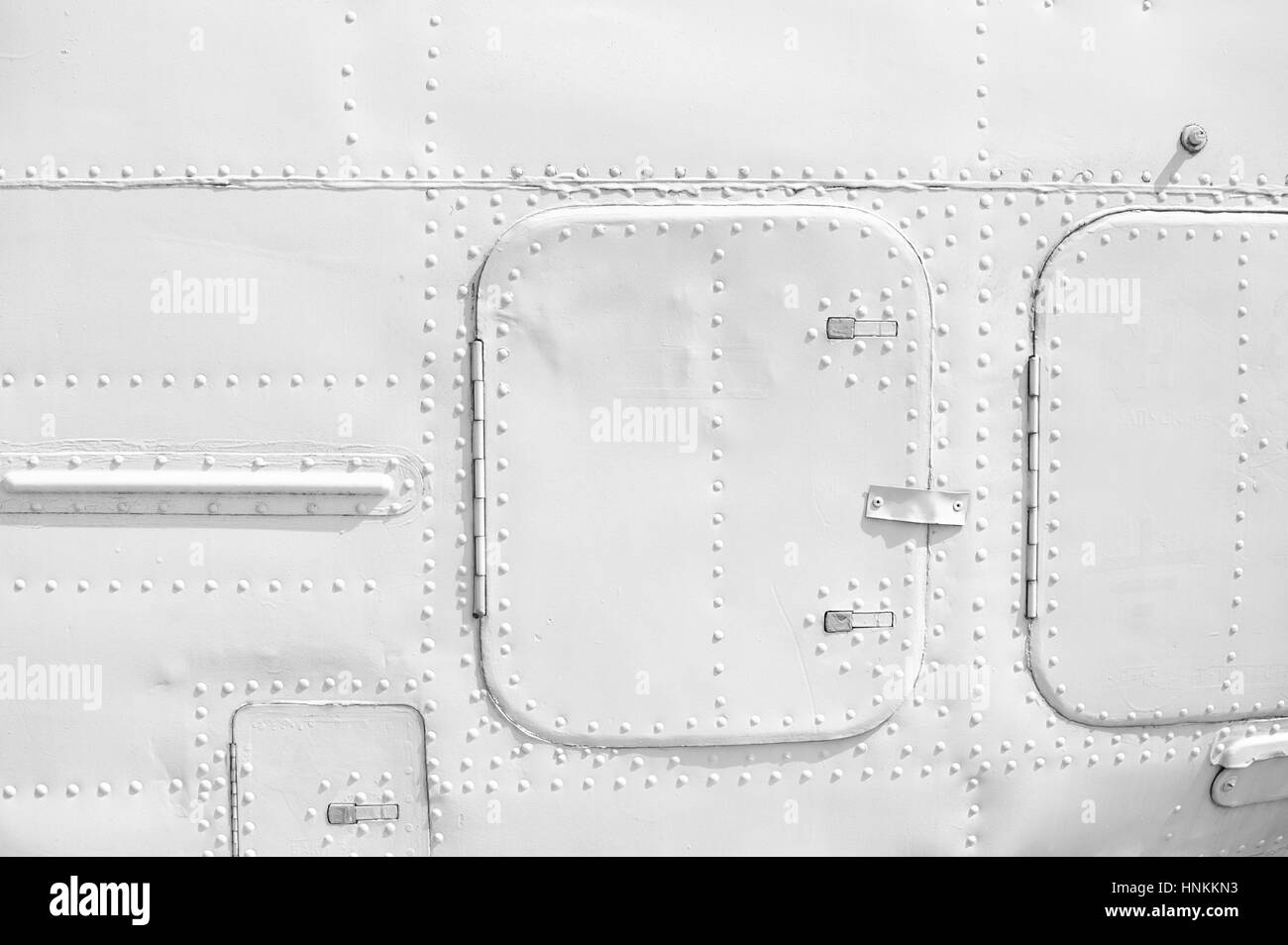 Aircraft metal plating texture with rivets - Stock Image