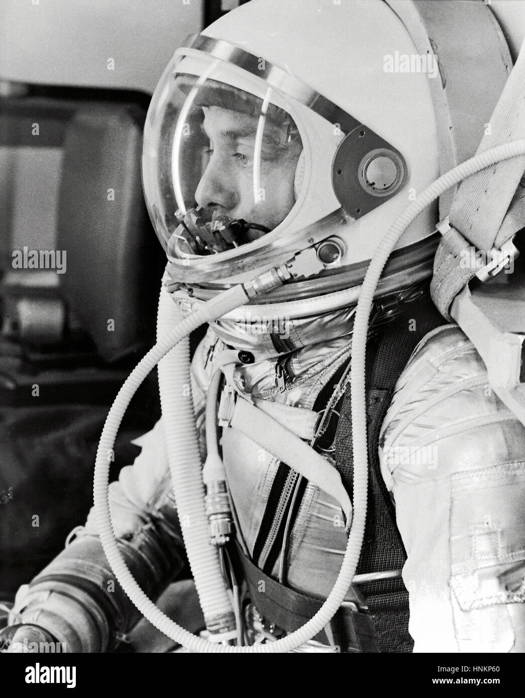 Astronaut Alan Shepard in his silver pressure suit with the helmet visor closed as he prepares for his upcoming - Stock Image