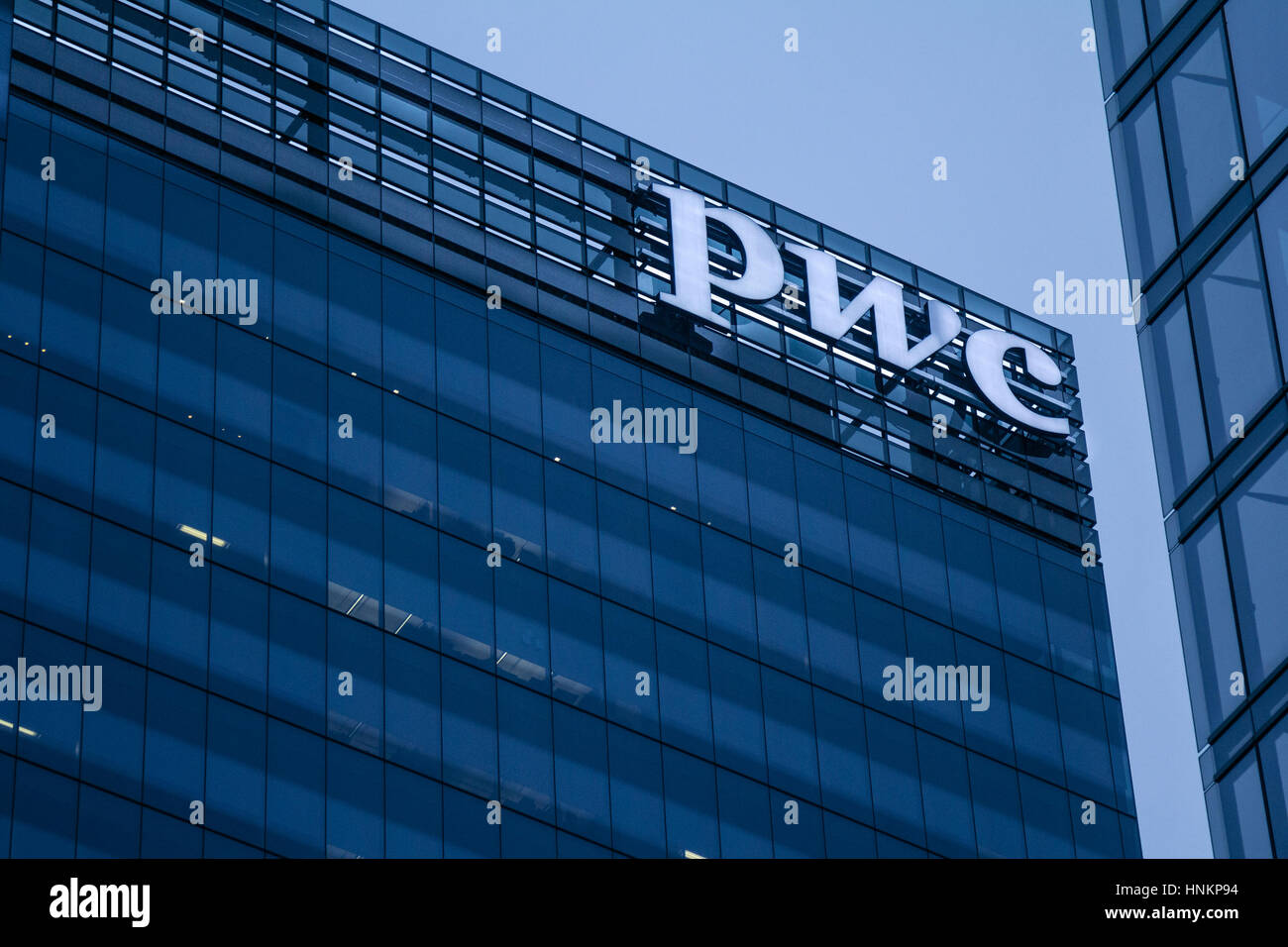 TORONTO, CANADA - DECEMBER 21, 2016: PWC (Pricewaterhousecoopers) main office for Canada in the evening in Toronto - Stock Image
