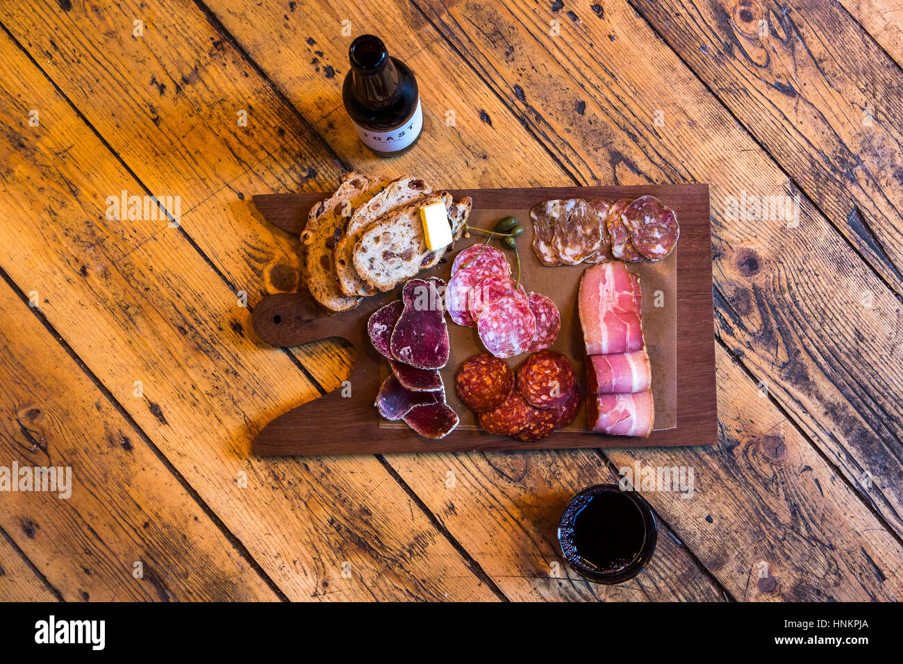 Charcuterie platter with craft beer. Stock Photo