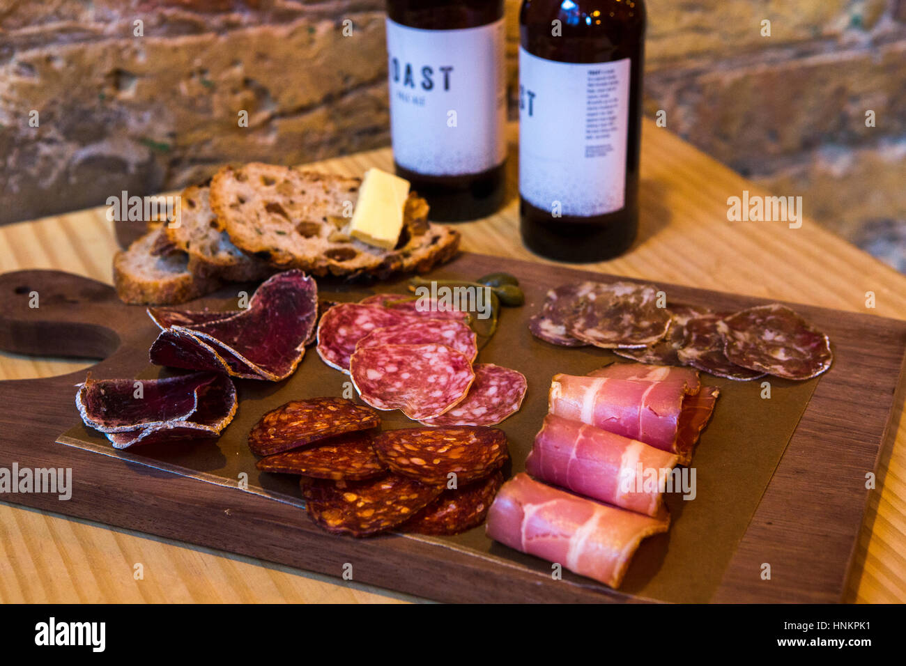 Charcuterie platter with craft beer. - Stock Image