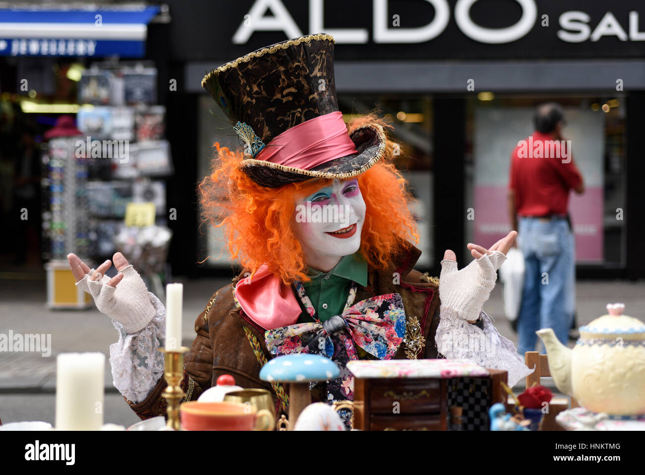 The Mad Hatter sitting at the tea table in Camden, London. - Stock Image