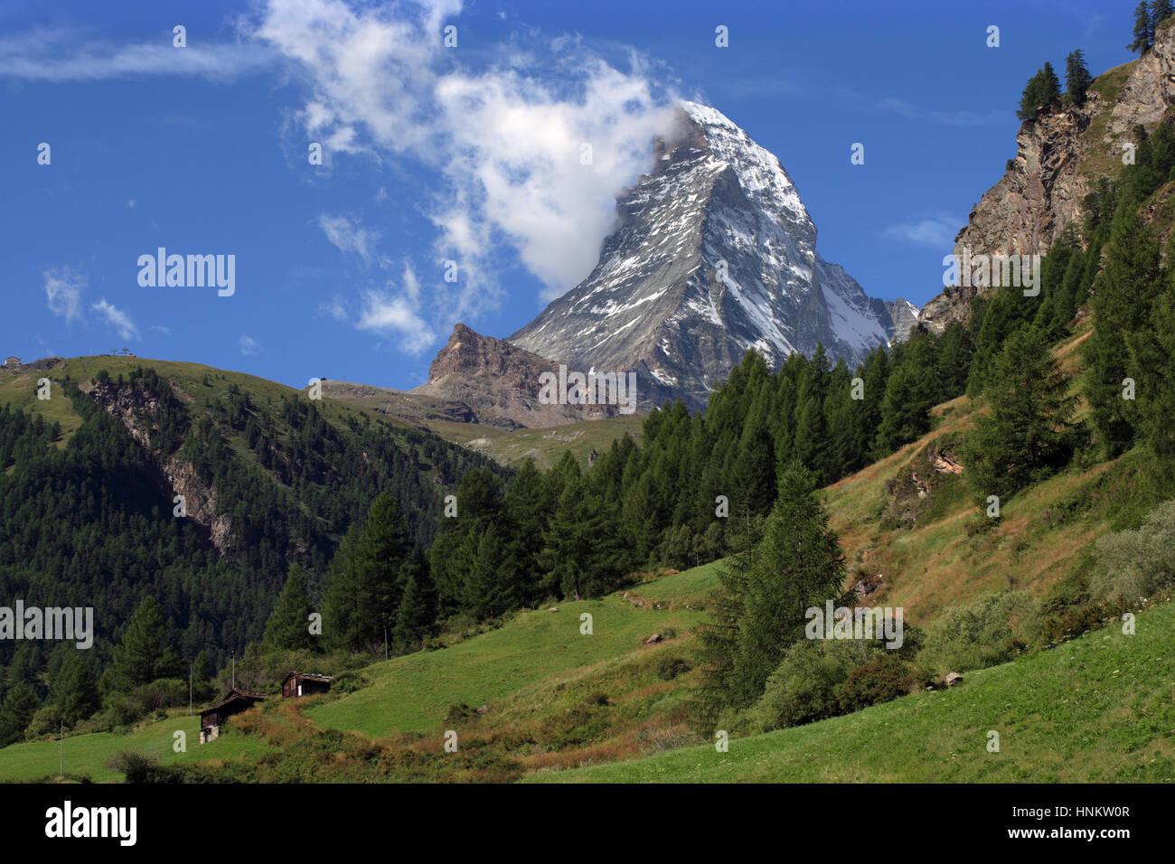 Photo of the incredible Matterhorn capturing some clouds in Zermatt Switzerland. - Stock Image