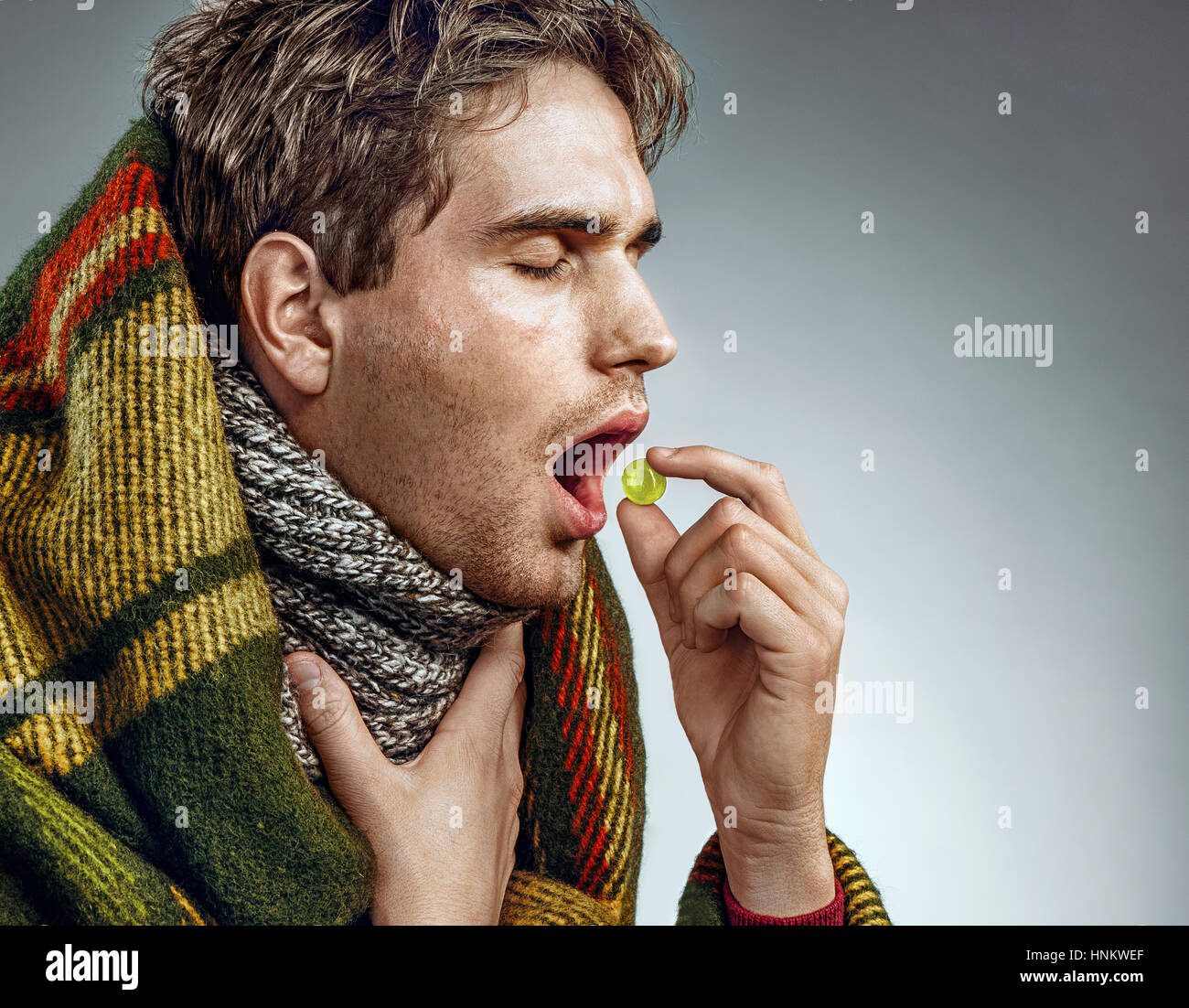 Man With Open Mouth Take Pill For Throat P O Of Sick Man Wrapped In Blanket On Grey Background