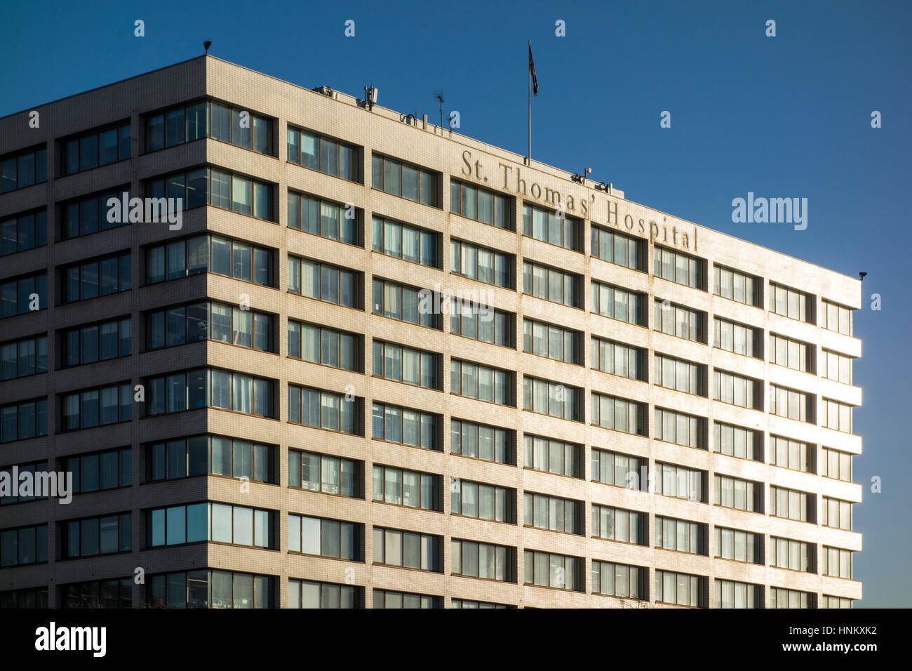 Bright sunlight hitting the side of St Thomas' Hospital building, London, UK - Stock Image