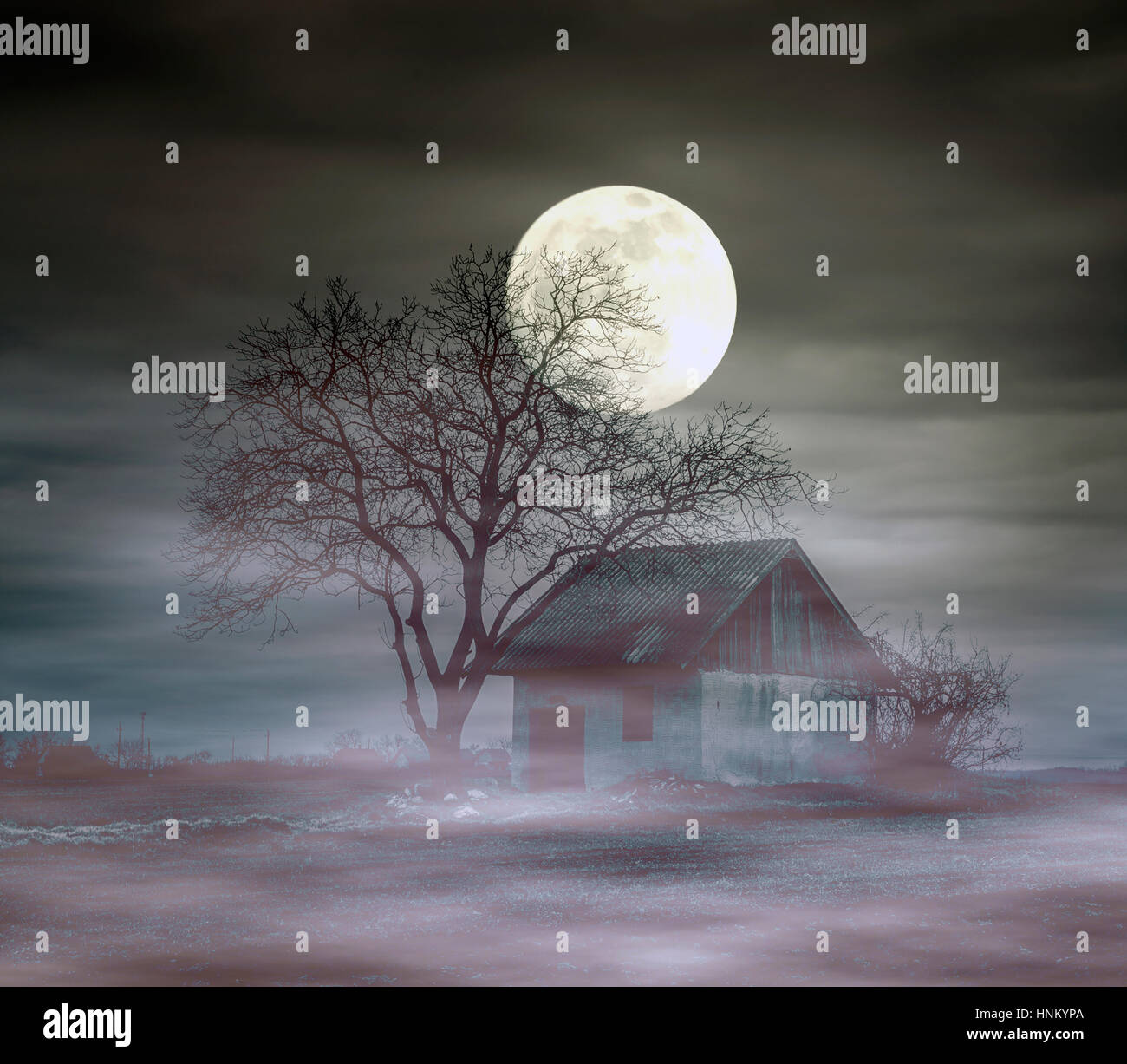Spooky ghost house at night - Stock Image