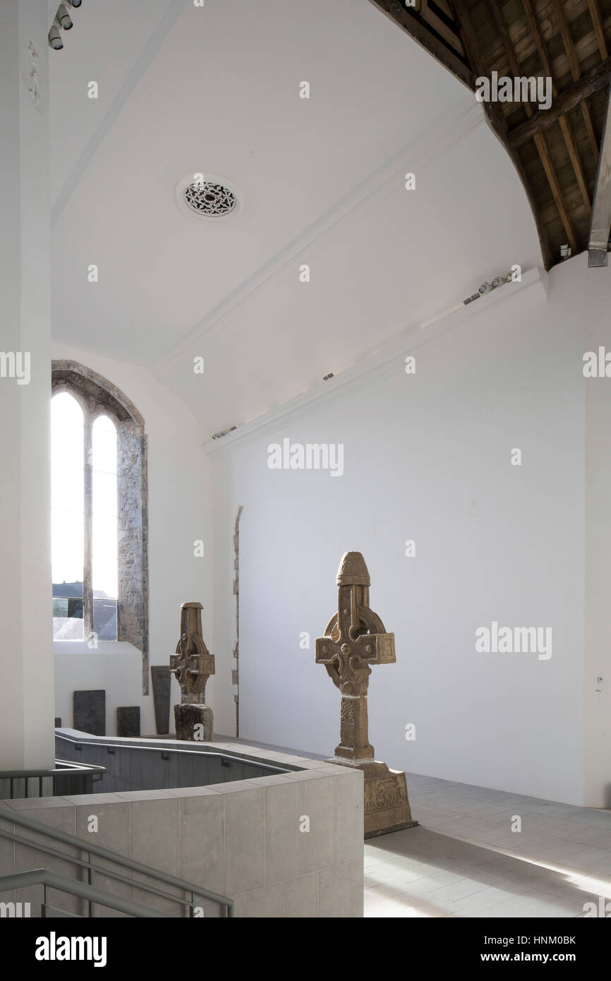 Refurbished nave volume with modern ramp and medieval tombstones  St