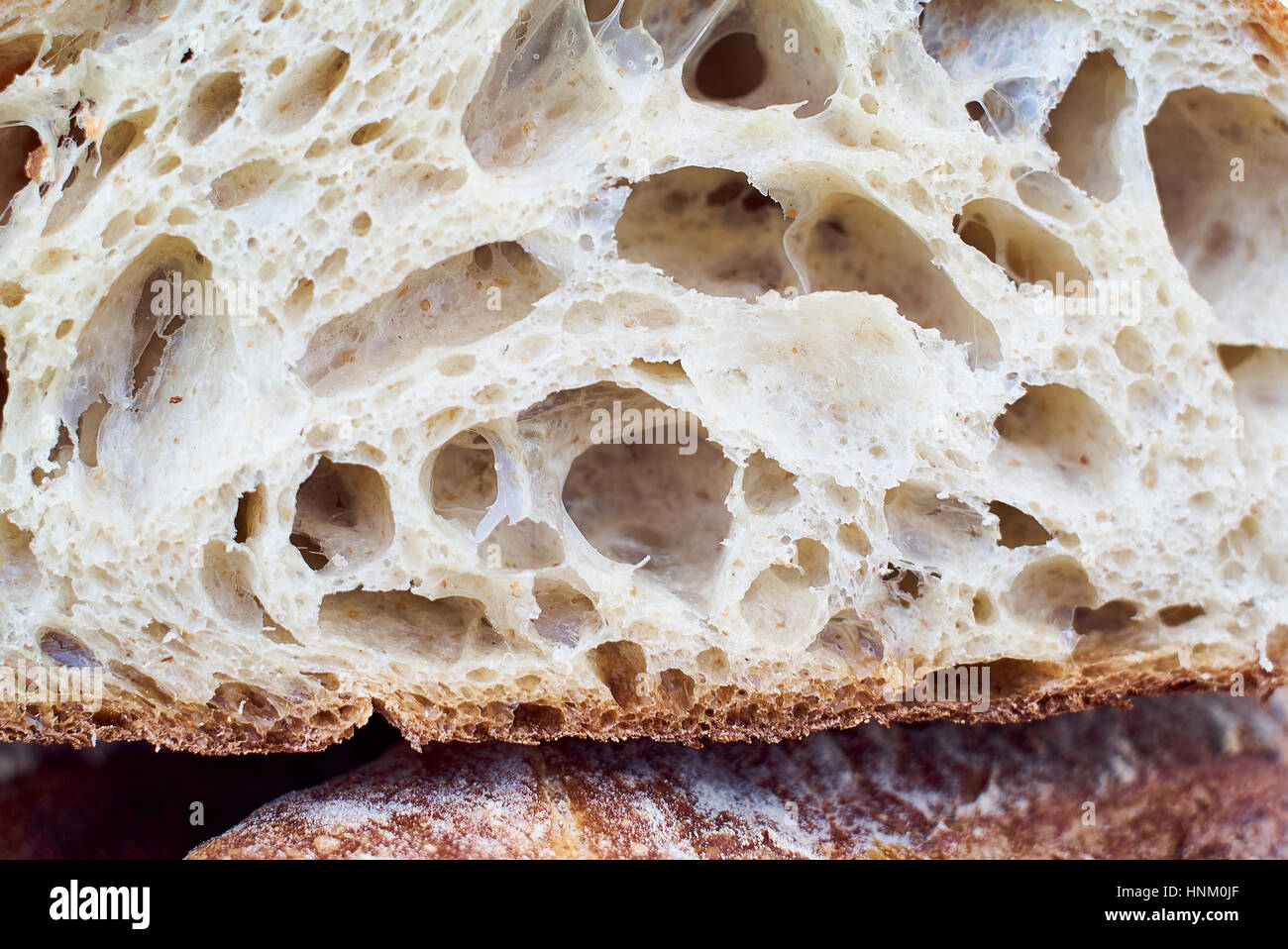 Cut artisan bread loaf in detail - Stock Image