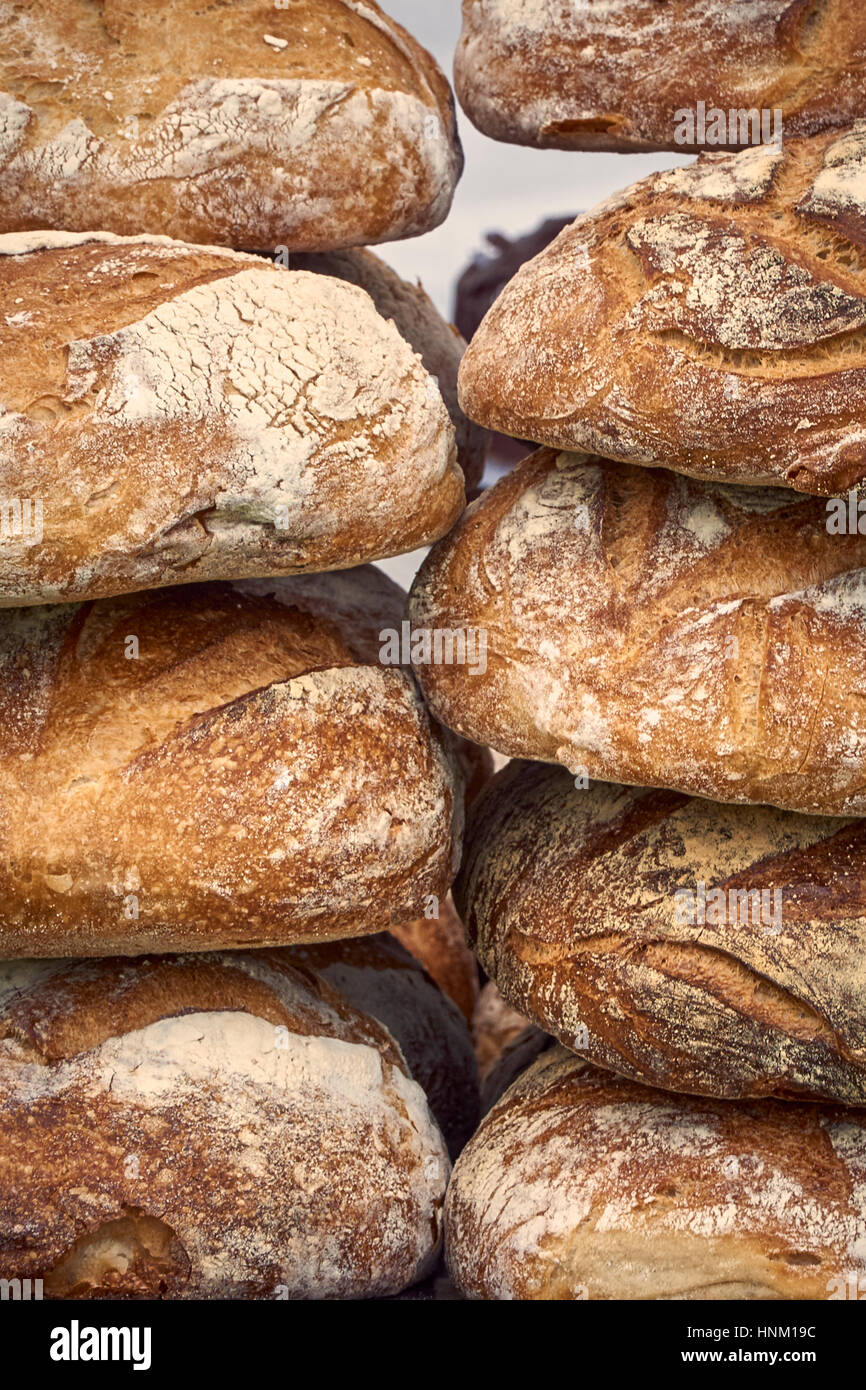 A stack of artisan bread loaves - detail - Stock Image