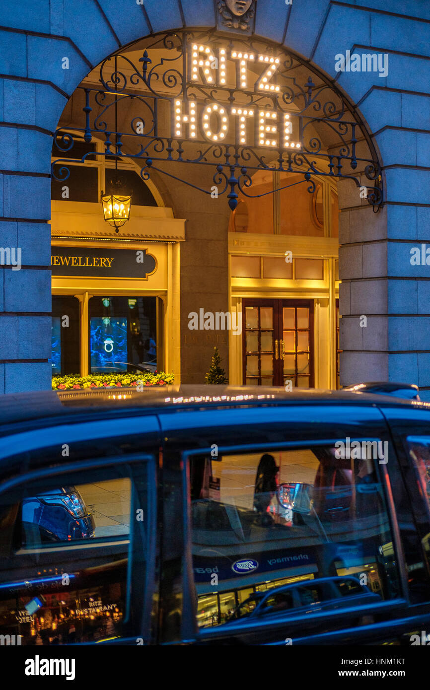 London Cab at The Ritz Hotel at Night,Piccadilly,London,England - Stock Image