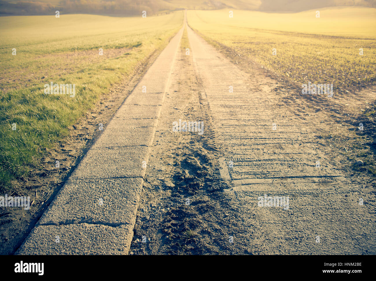 A long straight road leading to a vanishing point - Stock Image