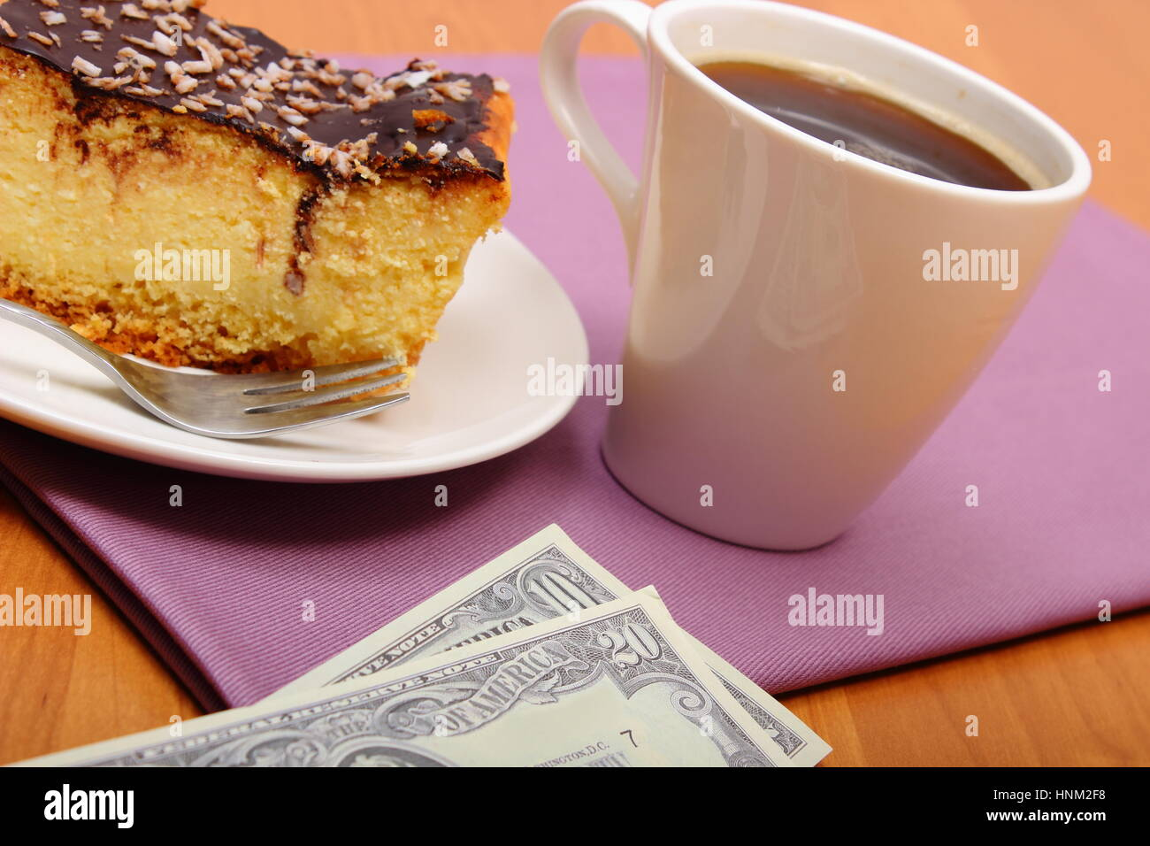 Paying for food in the cafe or restaurant, cheesecake and coffee, currencies dollar, finance concept - Stock Image