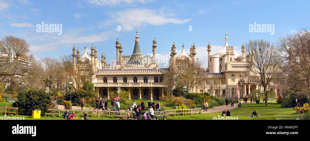 Brighton, United Kingdom - April 16, 2012: Panoramic view of Tourists on the grass enjoying a Spring day infront - Stock Image