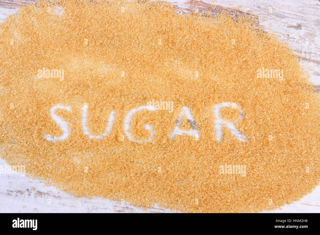 Word sugar written in granulated natural brown cane sugar - Stock Image